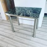 stainless steel custom fabricated table frame with granite top